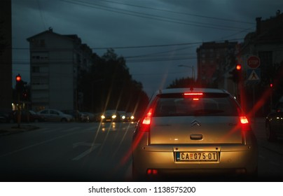 Cacak, Serbia - July 19, 2018: Red light on semaphore, view from car on evening scene from cross section in Nemanjina street.