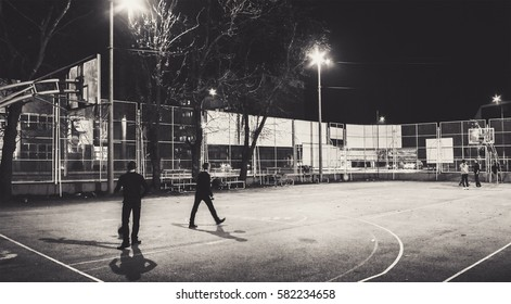 Cacak town in Serbia, cinematic view of the basketball court during night.