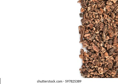 Cacao nibs over white background