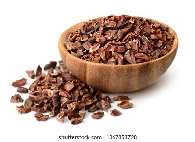 cacao nibs in the wooden bowl, isolated on white background