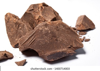 Cacao paste or mass (Theobroma cacao). Broken chocolate pieces ingredients for making chocolate.