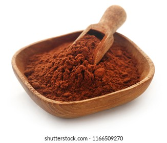 Cacao Powder in a bowl and scoop over white background