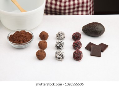 cacao truffles with ingredients and baker in background