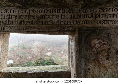 Caceres, Spain. - February 18, 2018: Frescoes and paintings very deteriorated in the ruins of the old hermitage of San Jorge. Caceres. Extremadura. Spain.