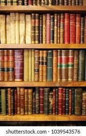 Caceres, Spain - June 10, 2013: Antique books, library, bookshelves inside a bookstore