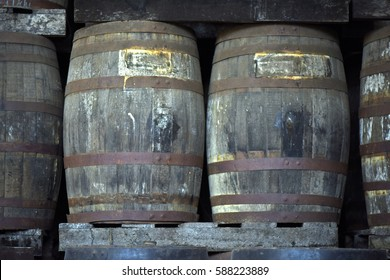 Cachaca and grain alcohol aged in old wooden barrels