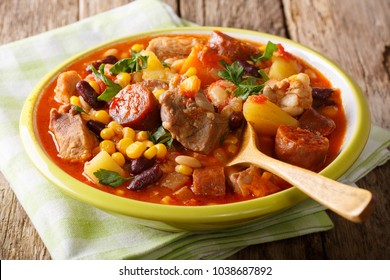 Cachupa is the signature dish of the Cape Verde Islands in Africa. Is a slow cooked stew of corn, beans, vegetables and meat.