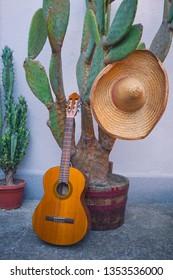 Cactus and guitar and sombrero as Mexican symbols. Cinco de Mayo concept