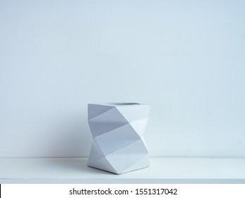 Cactus pot. Concrete pot. Empty modern geometric concrete planter on white wooden shelf isolated on white background.