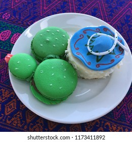 Cactus shaped macaroon and sombrero topped coconut dessert on colorful Mexican tablecloth