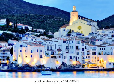Cadaqeus, Costa brava, Spain: cathedral and Old Town with sailing boat.