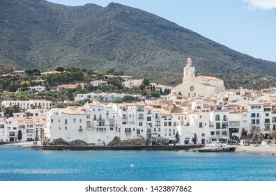 CADAQUES, SPAIN - MARCH 31, 2019: Spain Mediterranean village of Cadaques, whitewashed houses and the church Santa Maria, Costa Brava, Alt Emporda, Catalonia, Cap de Creus