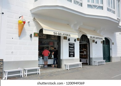 CADAQUES, SPAIN - SEPTEMBER 6, 2018: Glacier with a sign of ice cream cone in Cadaques small Spanish village of Catalonia