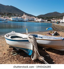 Cadaques traditional fishing village with tourists by Mediterranean coast, white town where painter Salvador Dalí lived, Cadaqués close to Barcelona, Costa Brava, Girona, Spain. Squared picture 1x1