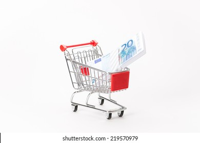 Caddy for shopping  with money stack on white background