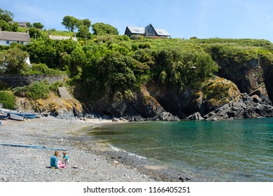 CADGWITH, ENGLAND - JUNE 21: Mother and daughter on the beach at Cadgwith Cove. In Cadgwith, Cornwall. On 21st June 2018.