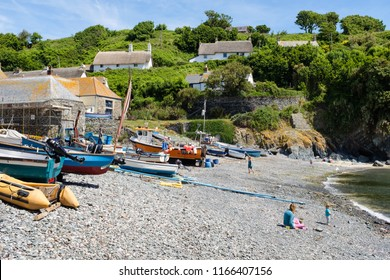 CADGWITH, ENGLAND - JUNE 21: Tourists visiting the traditional, and beautiful fishing village of Cadgwith Cove. In Cadgwith, Cornwall. On 21st June 2018.