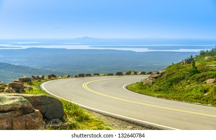 Cadillac Mountain drive in Acadia National Park, Maine in a clear summer day. A panoramic view of distant lakes and hills.