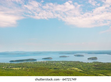 Cadillac Mountain view of Bar Harbor and islands at mid-day