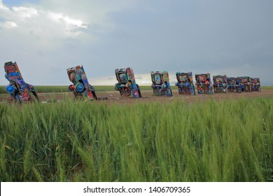 Cadillac Ranch, located originally along Route 66 and currently along Interstate 40  is a public art sculpture of antique Cadillacs buried nose-down in a field - Amarillo, Texas, USA - May 23, 2019