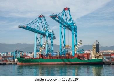 Cadiz, Andalusia, Spain - February 23, 2019: Cranes and container ships in the industrial port of Algeciras