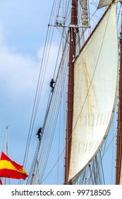 CADIZ, SPAIN - APR 01: Sailors spreading sails on the Spanish Navy Training Ship, Juan Sebastian de Elcano setting sail on the 83rd cruise of instruction on April 01 , 2012, in Cadiz , Spain