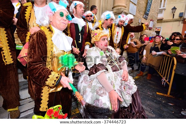 CADIZ, SPAIN - FEBRUARY 8: Typical carnival chorus (chirigota) sing during the carnival in the streets in January 8, 2016 in Cadiz, Spain.