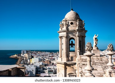 CADIZ, SPAIN - January 04, 2019: An aerial top view of the roofs of Cadiz, from the belfry of Cathedral Campo del Sur and the ocean. Andalusia, Spain. Editorial use only