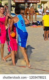 CADIZ, SPAIN - JULY 19: Unidentified players compete in a match between Zonabalonmano.com and CadizSur Seguros BMPY in the 19th league of beach handball of Cadiz on July 19, 2011 in Cadiz, Spain