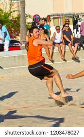 CADIZ, SPAIN - JULY 19: Unidentified players compete in a match between Los Negritos and Autoescuela Barquin in the 19th league of beach handball of Cadiz on July 19, 2011 in Cadiz, Spain