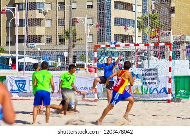 CADIZ, SPAIN - JULY 19: Unidentified players compete in a match between Zonabalonmano.com and BMPY Los Coñetas in the 19th league of beach handball of Cadiz on July 19, 2011 in Cadiz, Spain