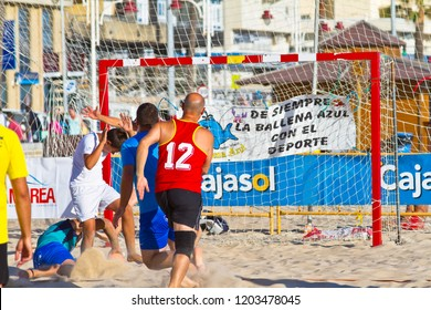 CADIZ, SPAIN - JULY 19: Unidentified players compete in a match between BMPY LAM Chiclana and Los Legendarios in the 19th league of beach handball of Cadiz on July 19, 2011 in Cadiz, Spain