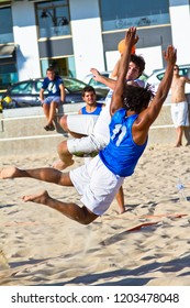 CADIZ, SPAIN - JULY 19: Unidentified players compete in a match between Valcarcel Recuperado and DecoHogar in the 19th league of beach handball of Cadiz on July 19, 2011 in Cadiz, Spain