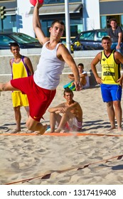 CADIZ, SPAIN - JULY 19: Unidentified players compete in a match between Los Negritos and Ademar Adentro in the 19th league of beach handball of Cadiz on July 19, 2011 in Cadiz, Spain