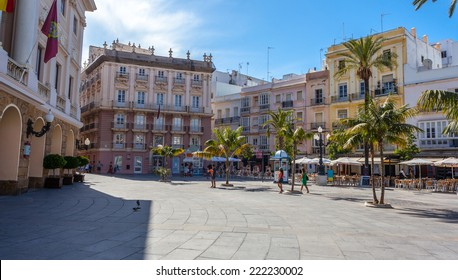 """Cadiz, Spain July 2014. The """"San Juan de Dios"""" Square of Cadiz is also known as the Town Hall Square. In the center of the image the House of """"Pazos de Miranda"""" built in 1795 by Miguel Olivares."""