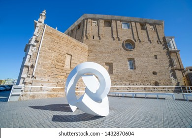 Cadiz, Spain - May 31th, 2019: View of modern abstract sculpture in street close to cathedral, Cadiz, Andalusia, Spain