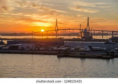 Cadiz, Spain -  November 2, 2018: Bay of Cadiz with the commercial port and the cable-stayed Constitution of 1812 Bridge or La Pepa Bridge late in the evening at sunset