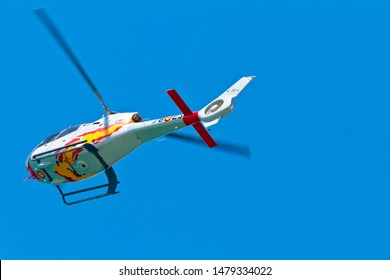 CADIZ, SPAIN-SEP 11: Helicopters of the Patrulla Aspa taking part in an exhibition on the 4th airshow of Cadiz on Sep 11, 2011, in Cadiz, Spain