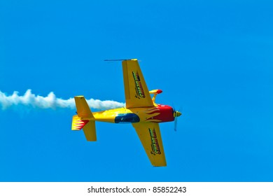 CADIZ, SPAIN-SEPT 11: Aircraft Extra 300S of Melissa Pemberton taking part in an exhibition on the 4th airshow of Cadiz on Sept 11, 2011, in Cadiz, Spain