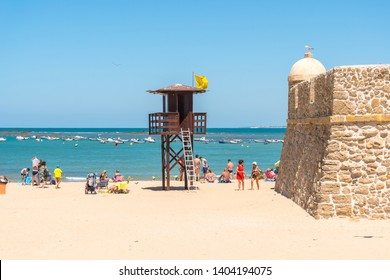 Cadiz,Spain-august 9, 2017:people on the beach near the lifeguard tower in Cadiz  during a sunny day