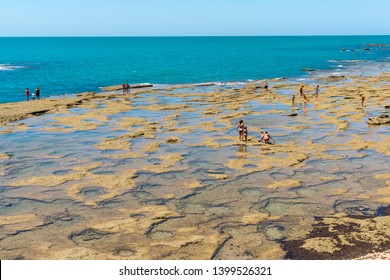 Cadiz,Spain-august 9, 2017:people play on the beach of Cadiz during a sunny day