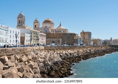 Cadiz,Spain-august 9, 2018:seafront promenade of Cadiz with the cathedral view during a sunny day