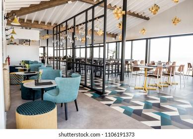 CADZAND, NETHERLANDS - MARCH 14, 2018: Modern beach pavilion with mixed vinyl flooring