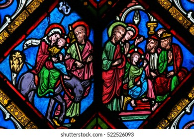 CAEN, FRANCE - FEBRUARY 12, 2013: Stained Glass window in the Cathedral of Caen, Normandy, France, depicting the Flight to Egypt and Christ among the Doctors