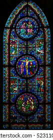 CAEN, FRANCE - FEBRUARY 12, 2013: Stained Glass window in the Cathedral of Caen, Normandy, France, depicting various New Testament Scenes