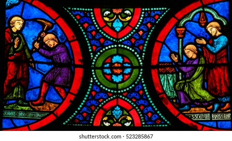 CAEN, FRANCE - FEBRUARY 12, 2013: Stained Glass window in the Cathedral of Caen, Normandy, France, depicting Saint Stephen, venerated as the Protomartyr or first martyr of Christianity.