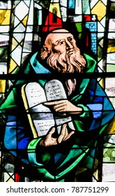 Caen, France - February 12, 2013: Stained Glass window in the Cathedral of Caen, Normandy, France, depicting Moses and the Stone Tablets with the Ten Commandments