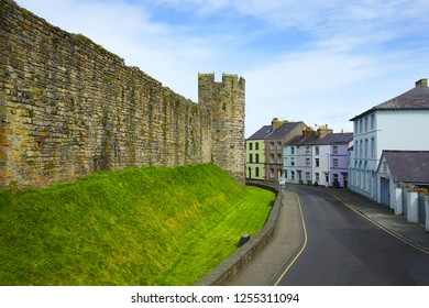 CAERNARFON, NORTH WALES – AUGUST 20, 2017: Town Walls of Caernarfon. It belongs among Castles and Town Walls of King Edward in Gwynedd - UNESCO World Heritage site