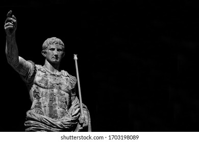 Caesar Augustus, first emperor of Ancient Rome and father of the nation. Old bronze statue along the Imperial Forum Road (Black and White with copy space)