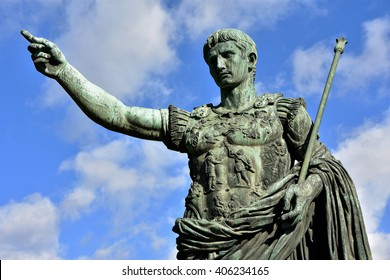 Caesar Augustus, the first emperor of Ancient Rome. Bronze monumental statue in the center of Rome, with beautiful sky